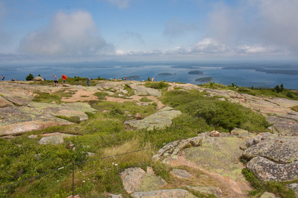 Visitors to Acadia National Park wander trails atop Cadillac Mountain, the tallest mountain on Mount Desert Island, in this July 2016 file photo.