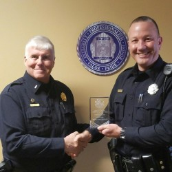 Bangor police Lt. Robert Bishop (left) presents the 2016 Chief Don Winslow Community Service Award to Officer Jason McAmbley, the department's community relations officer.