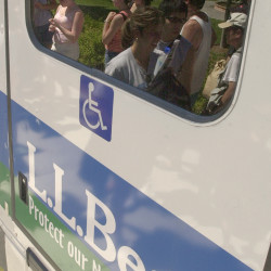 The L.L. Bean logo is visible on the back of an Island Explorer bus in this 2002 file photo. New rules adopted by the National Park Service last month have raised concerns that there could be increased visibility of corporate donors at national parks nationwide.