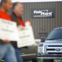 FairPoint employees conduct an informational picket in Bangor in this August 2014 file photo.