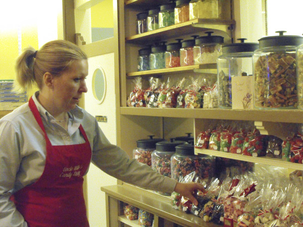 Karen Keber Sutton, proprietor of Uncle Willy's Candy Shoppe in Houlton, stocks shelves at her Main Street store in this Dec. 2009 photo. The store is closing on Saturday.
