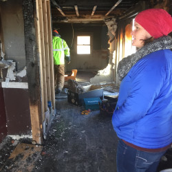 Ashley Sorrentino (right) and her husband, Adam, work to gut their house after a devastating mid-December fire. They were not able to get homeowner's insurance because their sole source of heat was a woodstove.