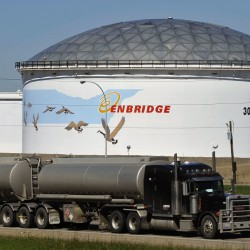 A storage tank looms over a freeway at the Enbridge Edmonton terminal in Edmonton in this, Aug. 4, 2012.