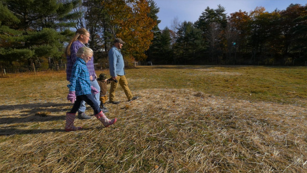 Retired United States Army veterans Walter (right) and Aaron (second from left) Morse walk their farm with their children, Paige (left) and Joseph, in this undated photo. The family is part of an upcoming series called &quotGrowing Home,&quot which is looking at Maine's veteran farmers.