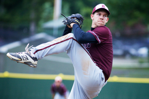 Washington Academy pitcher Gage Feeney winds up at St. Joseph's College in Standish as his team defeats Sacopee Valley High School for the State Class C Baseball Championship on June 21, 2014.