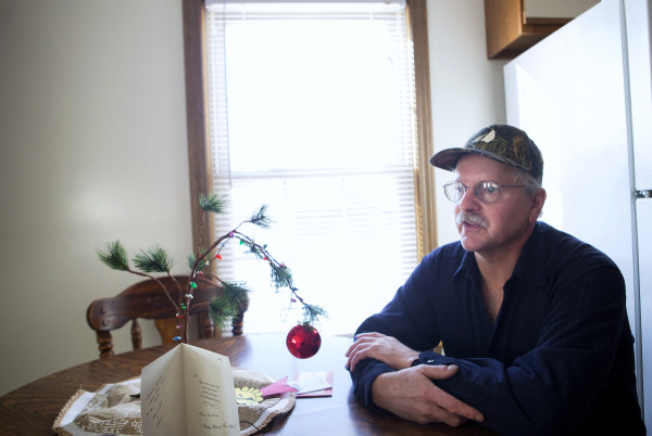 Tom Picard sits in his home in Millinocket Saturday. Picard says he lives &quotthe new normal.&quot As a millworker, Tom has been laid off 10 times since 1980. For the last few years he has been making the weekly commute to his new job 130 miles away, at the Huhtamaki plant in Waterville. This past summer, he divorced his wife, Tammy Shorey Picard, as the commuting was putting a strain on their relationship.