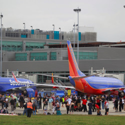 People on the airport ramp area near terminals 1 and 2 are seen following a shooting incident on Friday at Fort Lauderdale-Hollywood International Airport in Fort Lauderdale, Florida.