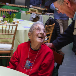 Gerry Palmer (right) laughs with Clara Swan during Swan's 104th birthday celebration at Husson University's Beardsley Meeting House in Bangor on April 28, 2016.