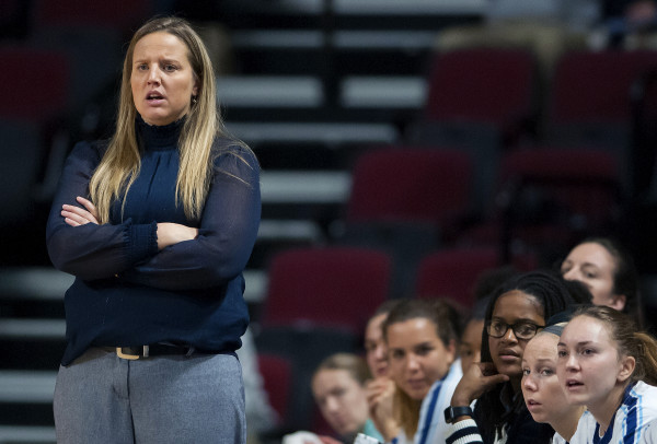 University of Maine interim coach Amy Vachon watches as her team faces University of Maryland, Baltimore County, at the Cross Insurance Center in Bangor on Saturday. Vachon is coaching the team in the absence of head coach Richard Barron, who is on medical leave for an undisclosed illness.