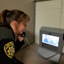 Officer Lori Marks of the York County Sheriff's Office demonstrates a video visit at the York County Jail.