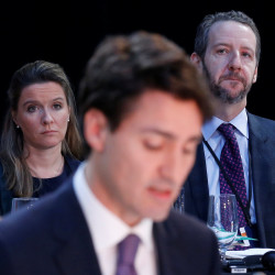 Canadian Prime Minister Justin Trudeau's chief of staff, Katie Telford (left), and principal secretary, Gerald Butts (right), listen as Trudeau speaks during the First Ministers' meeting in Ottawa, Ontario, in this December 2016 file photo.