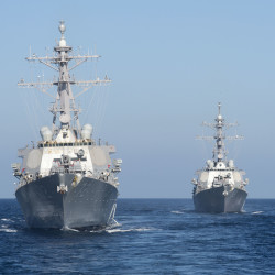 The Arleigh Burke-class guided-missile destroyers USS Mahan (DDG 72) (left) and USS Laboon (DDG 58) participate in a divisional tactics exercise with USS Cole (DDG 67) and Ticonderoga-class guided-missile cruiser USS Philippine Sea (CG 58) in this July 2016 file photo.