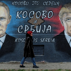 A woman walks past a mural of U.S. president-elect Donald Trump and Russian President Vladimir Putin in Belgrade, Serbia, December 4, 2016.
