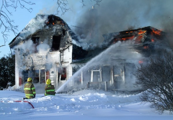 Firefighters battle a structure fire at 250 Hare Road in Monticello on Monday.