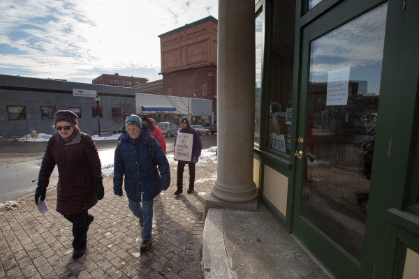 As part of a statewide campaign, voters walked up Harlow Street on Tuesday morning to visit the Bangor office of Sen. Susan Collins to protest her support for and introduction of Sen. Jeff Sessions for Attorney General.