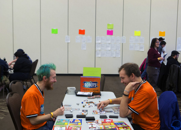 William Hessian (left) laughs with John Supinski while playing PBL Robots, a game the two invented, during the seventh annual SnowCon at the Cross Insurance Center in Bangor on Jan. 17, 2015.