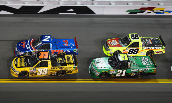 NASCAR Camping World Series driver Austin Theriault (2) and driver Grant Enfinger (33) and driver Matt Crafton (88) and driver Johnny Sauter (21) race during the NextEra Energy Resources 250 at Daytona International Speedway on Feb. 19, 2016.
