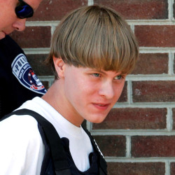 Police lead Dylann Roof into the courthouse in Shelby, North Carolina, in this June 2015 file photo.