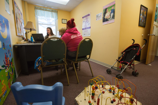 A WIC recipient and her son sit for an appointment at Bangor Public Health & Community Services on Jan. 12.