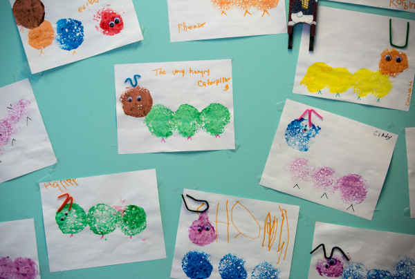 Children's drawings from behind the counter at Bangor Public Health & Community Services where WIC recipients have their appointments.