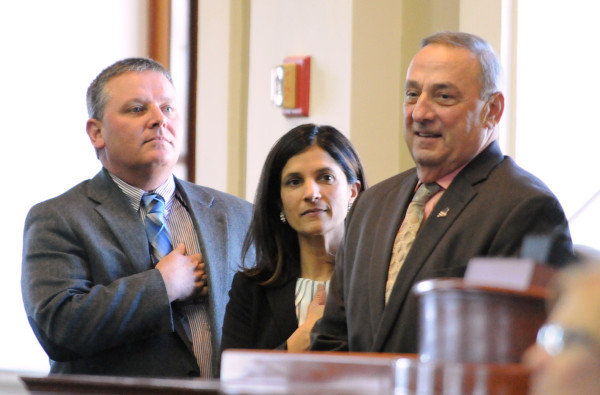 Senate President Michael Thobodeau (from left), Speaker of the House Sara Gideon and Gov. Paul LePage attend as the Maine electors of the Electoral College cast their secret ballots for president of the United States at the State House in Augusta, Dec. 19, 2016.