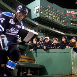Senior Mark Anthoine of the University of Maine climbs out of the tunnel at Frozen Fenway in Boston in 2014.