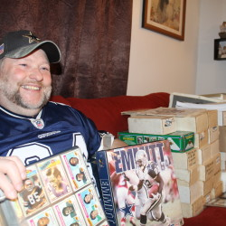 Dale Christensen, who is selling off $13,000 worth of sports cards and other memorabilia, shows off some of his cards recently in Fort Kent.