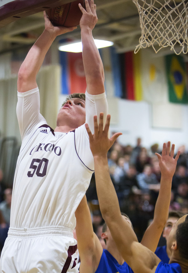 Orono's Keenan Collett (left) goes up for a layup past Hermon's Keenan Marseille during their basketball game in Orono Wednesday.