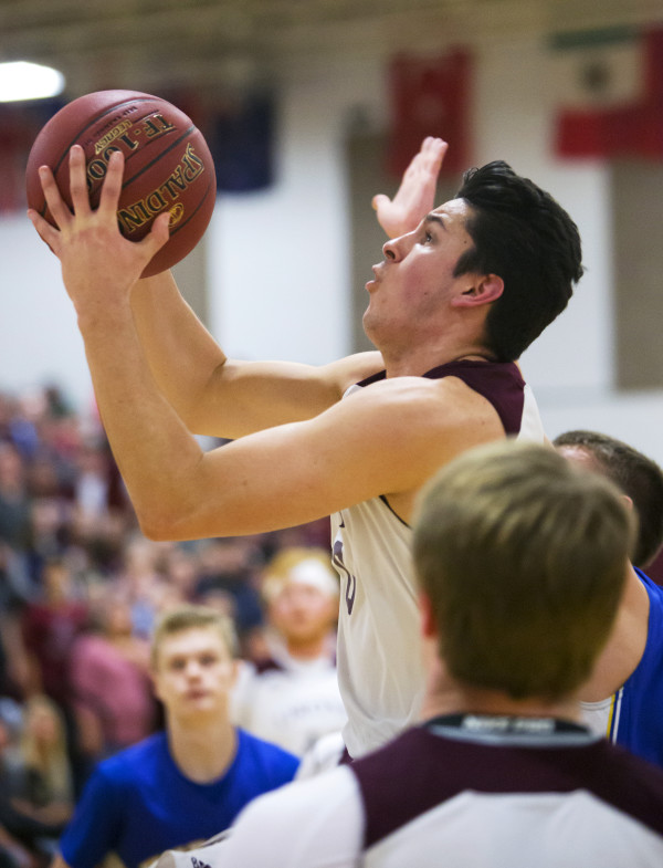 Orono's Nate Desisto tries for two past Hermon during their basketball game in Orono Wednesday.