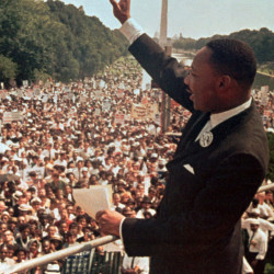 "Martin Luther King Jr. acknowledges the crowd at the Lincoln Memorial for his ""I Have a Dream"" speech during the March on Washington, D.C., Aug. 28, 1963."