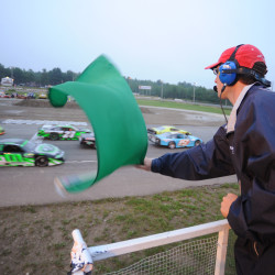 Flagman Jordan Harnish starts the Dysart's Late Model 40 lap race at Speedway 95 in Hermon, June 29, 2013.