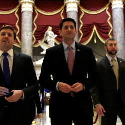 U.S. House Speaker Paul Ryan (center) walks to the House Chamber to vote on Obamacare repeal on Friday on Capitol Hill in Washington.