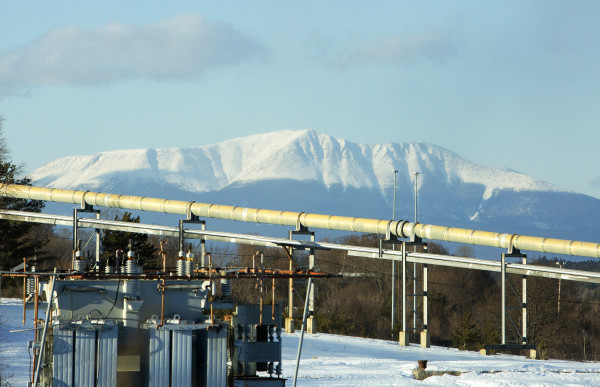 Mount Katahdin is seen behind pipes running through the former Great Northern Paper mill in Millinocket Friday.