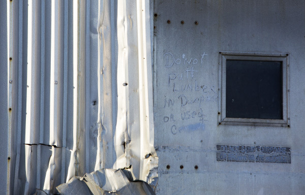 A reminder is written on a door at the former Great Northern Paper mill in Millinocket Friday.