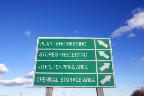 Directional signs are seen at the former Great Northern Paper mill in Millinocket Friday.
