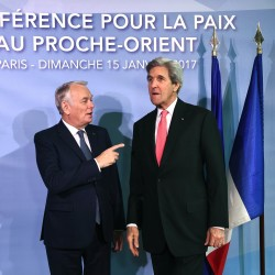 French Minister of Foreign Affairs Jean-Marc Ayrault welcomes U.S.  Secretary of State John Kerry as he arrives for the Middle East peace conference in Paris.