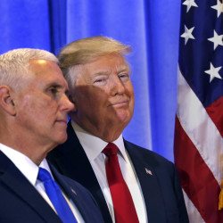 Vice President-elect Mike Pence stands with Donald Trump during a news conference on Wednesday at Trump Tower in New York.