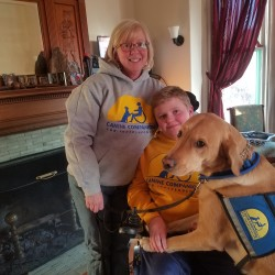 Gabe Schmick (center), 12, and his mother, Jean Schmick-Hopkins of Bangor can be seen with Gabe's skilled companion dog, Fenwick, on Sunday at their home in Bangor.