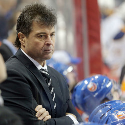 New York Islanders head coach Jack Capuano looks on against the Buffalo Sabres during the second period at Barclays Center on Dec. 24, 2016.