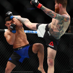 Drakkar Klose (left) blocks against a kick from Devin Powell during UFC Fight Night at Talking Stick Resort Arena in Phoenix, Arizona, on Sunday.
