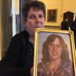 Sheila Simoneau holds a photo of her daughter, Wanda-Jean Mitchell. Mitchell was found dead in the woods in Poland in 1980. Simoneau, who lives in Buxton, joined other HAAD Enough Inc. parents at a news conference Tuesday calling for more help from the Maine State Police cold-case unit. She wants her daughter's case listed with the unit and her death investigated.