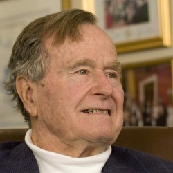 Former President George H.W. Bush smiles in this March 29, 2012 file photo.