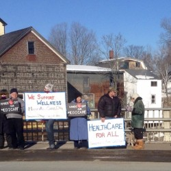 Local residents protested repeal of the Affordable Care Act in Dover-Foxcroft on Sunday.