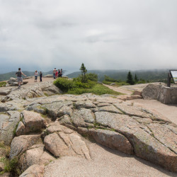 Visitors to Acadia National Park wander trails atop Cadillac Mountain in July 2016.