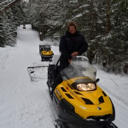 Tylor Kelly, 23, grooms a snowmobile trail on Feb. 20, 2016, in the Allagash region.