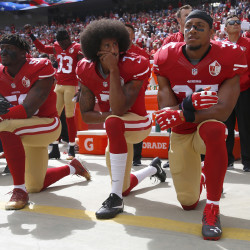 From left, San Francisco 49ers' Eli Harold (58), quarterback Colin Kaepernick (7) and Eric Reid (35) kneel during the national anthem before their NFL game against the Dallas Cowboys at Levi's Stadium in Santa Clara, California, Oct. 2, 2016.