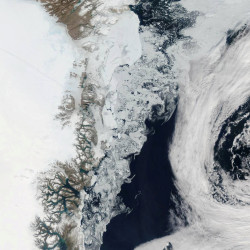 The Moderate Resolution Imaging Spectroradiometer aboard NASA's Aqua satellite captured this image showing large chunks of melting sea ice near Greenland on July 16, 2015.