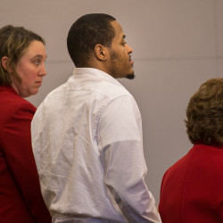 Keith Coleman (center), 29, makes a statement alongside defense attorney's Logan Perkin (left) and Martha Harris during his sentencing hearing on Thursday at the Penobscot Judicial Center in Bangor. Coleman was convicted of murdering his girlfriend and her two children.