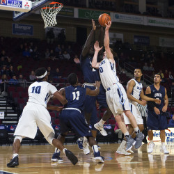 University of Maine's Andrew Fleming (right) tries for two past University of New Hampshire's Iba Camara during their basketball game at the Cross Insurance Center in Bangor Thursday.