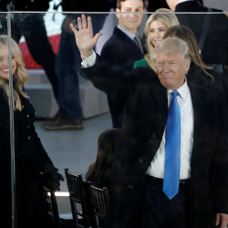 "President-elect Donald Trump waves from behind protective glass at the ""Make America Great Again! Welcome Celebration"" at the Lincoln Memorial in Washington, Jan. 19, 2017."